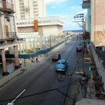  View from balcony showing street, hospital, sea, malecon