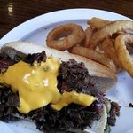 Philly Dog: Beef hot dog wrapped in bacon, deep fried, topped with cheese steak. Very creative a