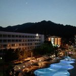 View of another hotel, from my front-facing balcony, at Kaya Maris (nice moon).