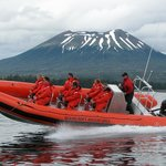 Volcano coast exploration by ocean raft.