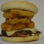 The Farmer John, emmantal, onion rings, fried egg, bacon - full of goodness - best seller