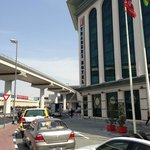  Front view of the Traders hotel and the Metro line, Dubai