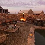 Stone Boma at night and splash pool
