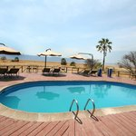  Small pool but with lounge chairs and view of Lake Manyara