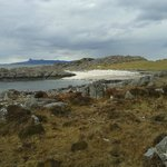 Deserted sandy cove at the end of the road to Rhue