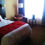 Room 125: one queen bed, main floor, river-facing.