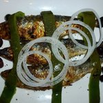 Sardines traditionally grilled on an open flame - entree