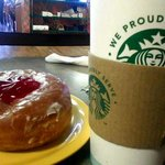 Charlie's hot coffee and scrumptious jelly donut