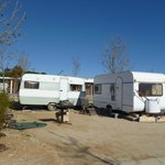 These look like abandoned caravans amongst  tourist pitches!