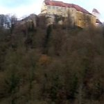  panoramic view from river valley looking up to castle