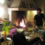  Open kitchen fireplace, food prep by host family