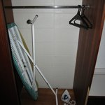 Iron and ironing board in cupboard