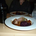 Roasted Duck served on winter vegetable stew with braised red cabbage