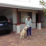 Guest with family dog at beachfront house