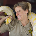  Farmer Jeanne &amp; Pink, the albino burmese python. (photo by Rob O&#39;Neal)