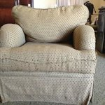 Worn chair with lumpy stuffing