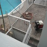 Power washing the pool area during our stay