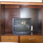  Small, old TV in front of the beds