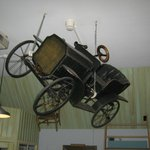  An old car suspended from the ceiling