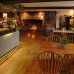  Bar with log burner, old oak beams, flooring and tables serving local real ales.