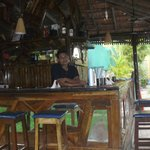  Babu bar tender behind the bar