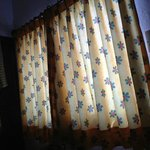  Nice nylon curtains... the bed was matching colors with different design