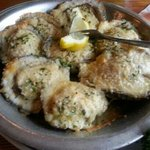  Baked oysters with parmesan cheese and fresh seasonings.