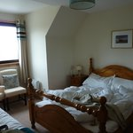 Our room with nice wooden bed
