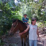 my son on the horse and Bruce