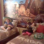 Kids enjoying their jungle themed bedroom.