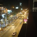 A view of the street at night, taken from the roof top terrace