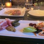 Salmon crudo, prosciutto and cheese plate.