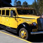 Antique bus outside Old Faithful Inn