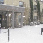 A snowy day at the hotel entrance