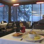 breakfast and heat lamps in the cafe's patio on a snowy day