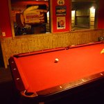 Pool table- left to pinball, right to bar and bed