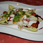 A delicious and fresh endive salad with goat cheese and Jamaican balsamic dressing