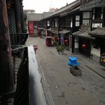  view of evening street life from our window in chengdu
