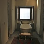 bathtub in suite 13 between the shower and toilet