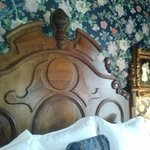 Antique king bed in Boyd room