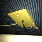 ANOTHER example of poor wiring behind bed, wires coming out from all directions..
