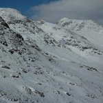 Crinkles and Bowfell inder snow from path to Red Tarn