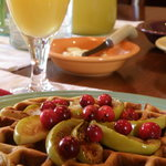  Hazelnut waffles with caramel apples and cranberries