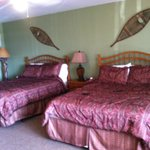 Two comfortable queen size beds, microwave & fridge in corner