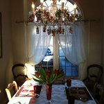 The dining room with the charming chandelier