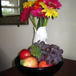  Flowers &amp; fresh fruit from their garden placed in our room.