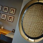 the raffia design screen between room and toilet