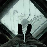 Looking down through the glass floor panels on the observation deck of the Moscow TV tower