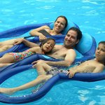  Family at play in the pool