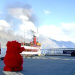 Cookie Muncher Mascott waving goodbye to Iconic Steam Ship